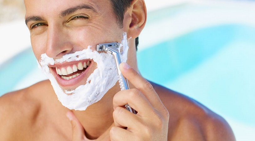 young man shaving his beard with razor reflected; Shutterstock ID 246752119; user id: 13315323; user email: info@qdaily.com; user_country: China; discount: 38%