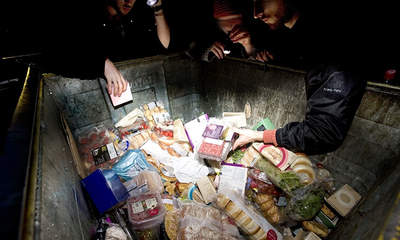 Freegans reclaiming food at night from bins outside a supermarket in Scotland